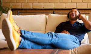 african american man chilling on his couch